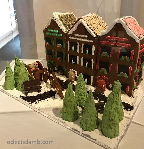 row houses gingerbread under glass at museum